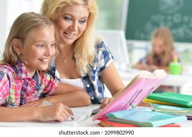 Teacher with two schoolgirls