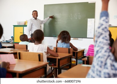 Teacher using chalkboard in a lesson at an elementary school