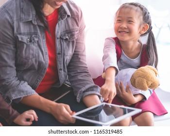 Teacher using tablet e book to tell little kid stories