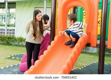 Teacher who take care of her children in playground at school