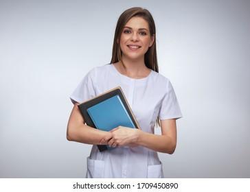 Teacher woman doctor dressed white medical uniform holding book isolated studio portrait.