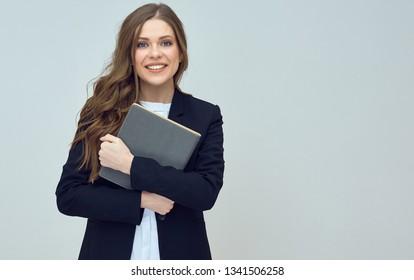 teacher woman wearing black suit holding book. isolated studio portrait.