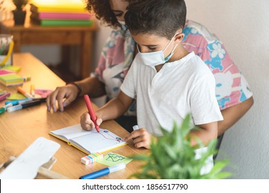 Teacher working with child boy at preschool during coronavirus outbreak - Soft focus on kid eye
