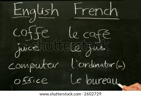 Стоковая фотография «teacher writing french lesson words on