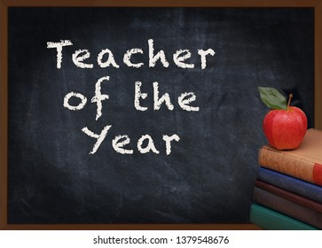 Teacher of the Year written on chalkboard with a stack of books and red apple