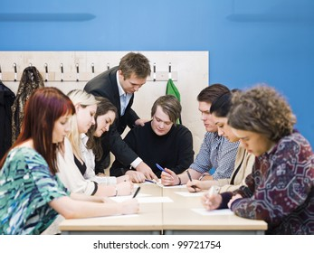 Teacher and young Adult students in the classroom