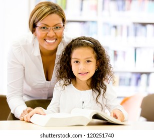 Teacher with a young student at the elementary school