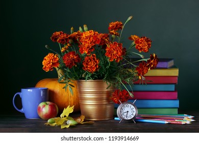 Teacher's day. Back to school. Still life with textbooks, bouquet and school supplies. September 1, knowledge day.