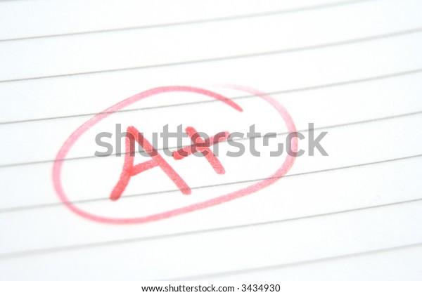 Teachers marking in red pen