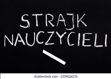 Teachers strike in Poland. Polish word TEACHERS STRIKE on a chalkboard.