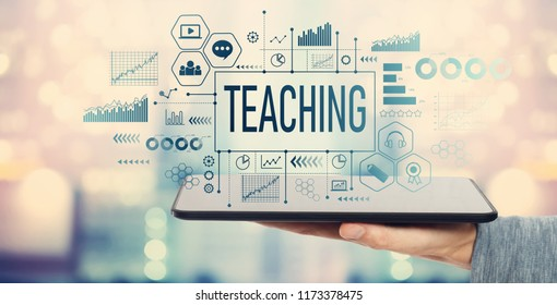 Teaching with man holding a tablet computer