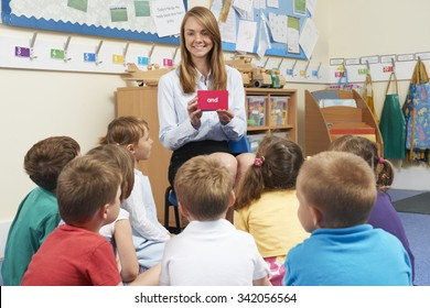 Teaching Showing Flash Cards To Elementary School Class