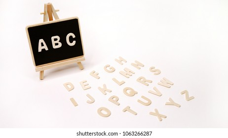 Teaching and Studying English Language for Student by A B C and Letters on Wooden blackboard