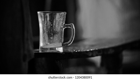 Teacups kept on a wooden bench isolated unique photo