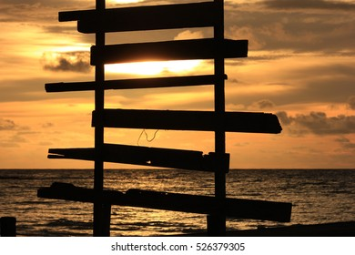 Teak bridge against sunset