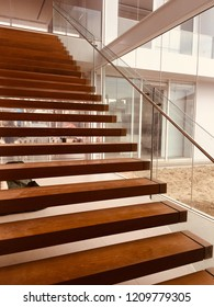 Teak wood style stairs on marble, choose focus, house model.Creating a home concept.