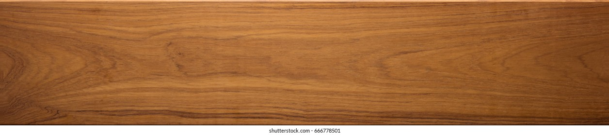 Teak wood (Tectona grandis)  wood texture, in wide format. Raw unfinished surface. Prized wood for durability and water resistance due to it's natural oils.