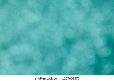 Teal abstract bokeh background.