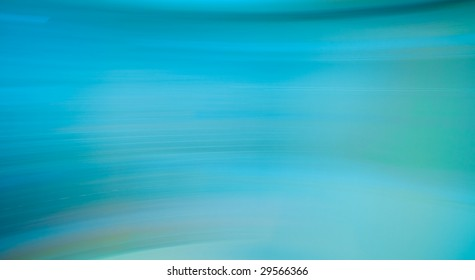 Teal blue abstract motion blur background.