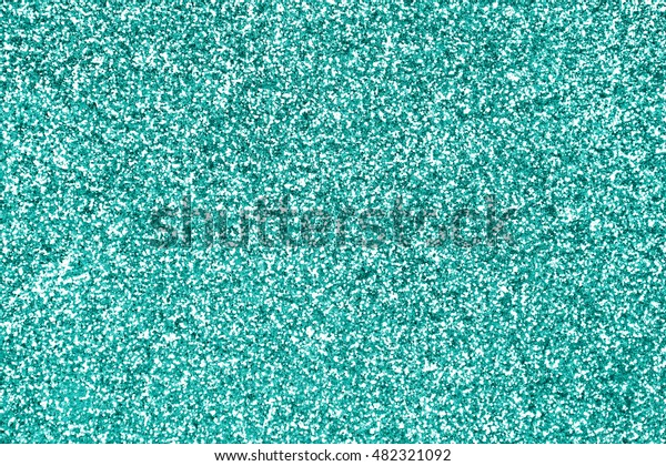 Teal green or turquoise and aqua glitter sparkle background texture or mint color party invite