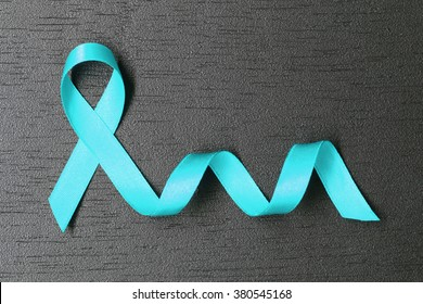 Teal ribbon. Ovarian cancer awareness. Healthcare and medicine concept.