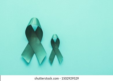 Teal ribbons on blue background, Ovarian Cancer, cervical Cancer, anti bullying and sexual assault awareness