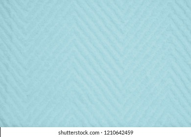 Teal soft chevron fabric towel with a pattern background
