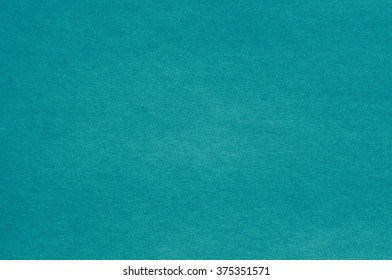 Teal/turquoise blue backdrop.