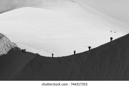Team of alpinists climbing a mountain