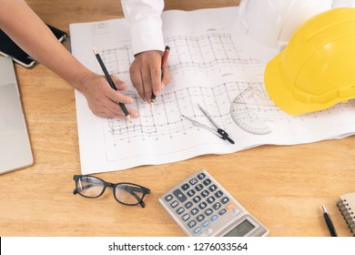 team of architect discuss about problem of house or building in office,plan is fake only for stock photo.