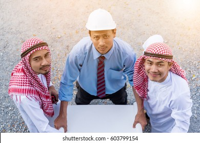 Team of architects engineer working together arabian businessman and they plan for theirs project, top view, copy space