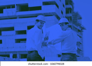 Team of architects people in group  on construciton site check documents and business workflow duo tone