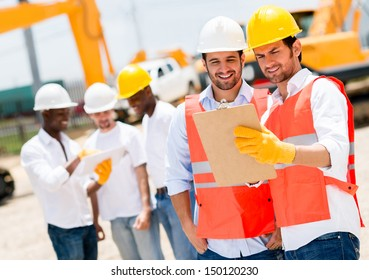 Team of architects working at a construction site