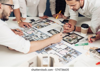 Team of architects working on construction plans