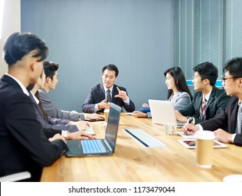 team of asian corporate business people men and women meeting in office.