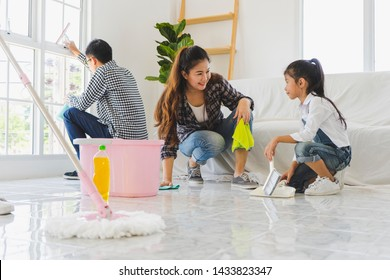 Team Asian Family cleaning house or new apartment together and having fun. Moving and start up, Cleaning House, residence, living, health concept