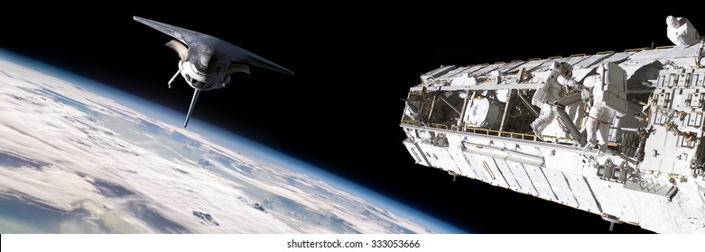 A team of astronauts performing work on a space station while the space shuttle slowly approaches to dock. - Elements of this image furnished by NASA.