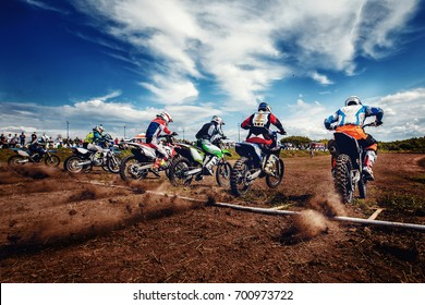Team athletes on mountain bikes start. Concept motorcross stunts, bike.