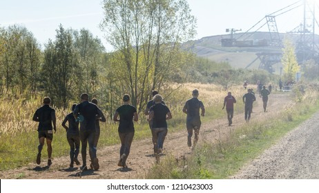 Team of athletes running in nature