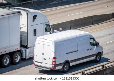 Team of Big rig semi truck with dry van semi trailer and compact cargo mini van driving side by side on the multiline highway road working hard together for timely delivery