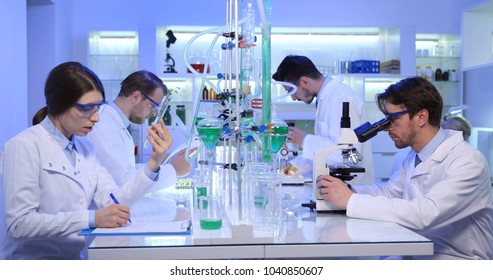 Team of Biologists Work Activity in Research Lab, Medical Scientists Workers Researching in Scientific Research Laboratory