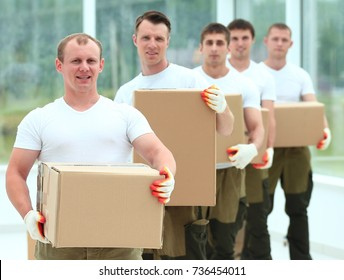 team of builders with boxes of building materials