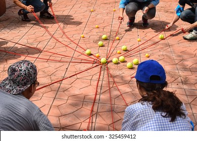 Team building activity, Tennis balls and table tennis balls with rope in harmonize activity