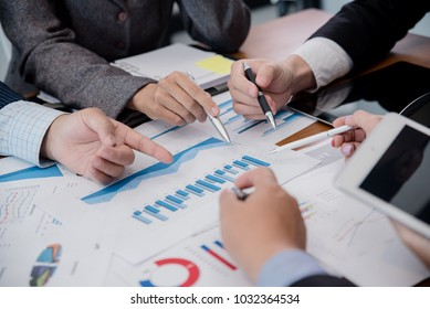 Team of business  investment consultant analyzing company annual financial report balance sheet statement working with documents graphs. Concept picture of economy, market, office, money and tax