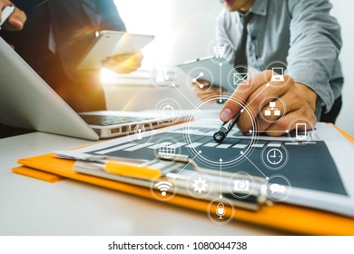 Team business meeting presentation. Hand businessman working   project in modern office.Laptop computer and tablet and smart phone on white desk in morning light