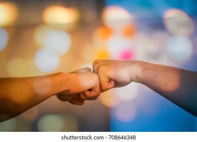 Team Business Partners Giving Fist Bump to Greeting Start up project with Contractor. Corporate Teamwork Partnership in an Office Meeting. Businessman with Hands together.