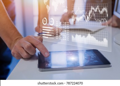 Team of business people analyzing marketing, sales, operations, financial, or trading metrics on digital analytics report dashboard with key performance indicators (KPI)