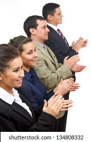 A team of business people clapping in line