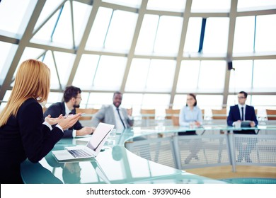 Team of business people discussing during a meeting