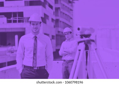 Team of business people in group, architect and engeneer  on construciton site check documents and business workflow on new building duo tone